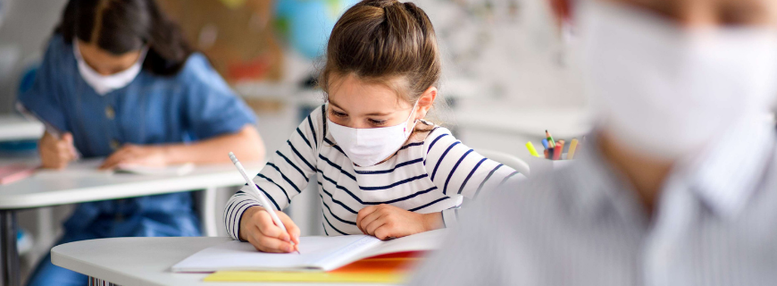 Child wearing mask in classroom