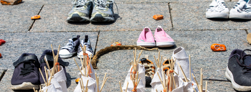 Photos of pairs of shoes. Each represents a child lost to the Indian Residential School System