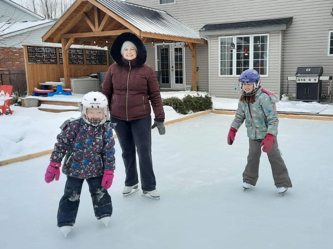 Nora and family skating