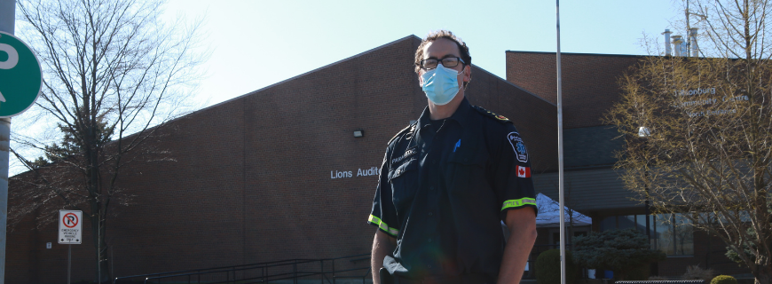 Picture of paramedic in front of Lions Auditorium in Tillsonburg