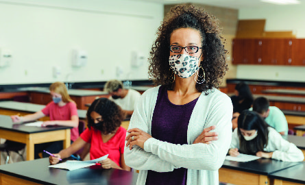 Teacher wearing a mask in a classroom