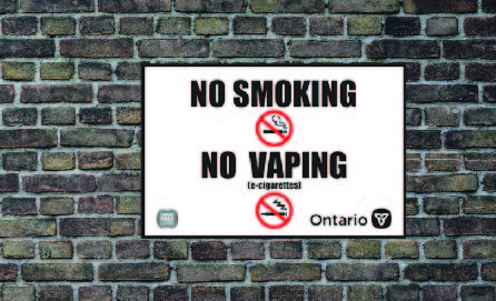 No smoking vaping sign on brick wall